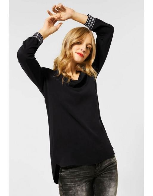 Lange blouse met glitter mouw
